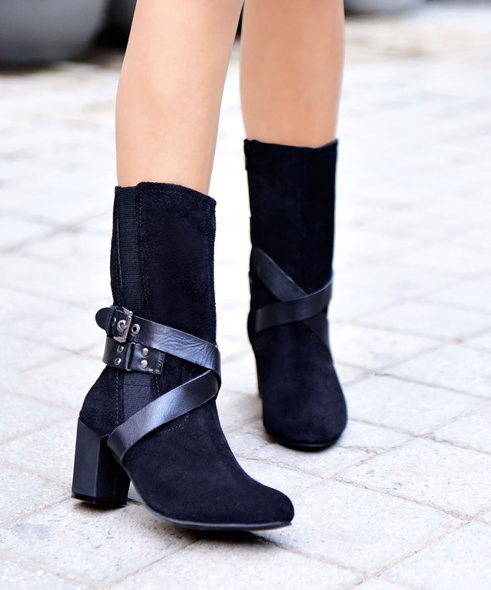 Criss cross black leather calf length boots