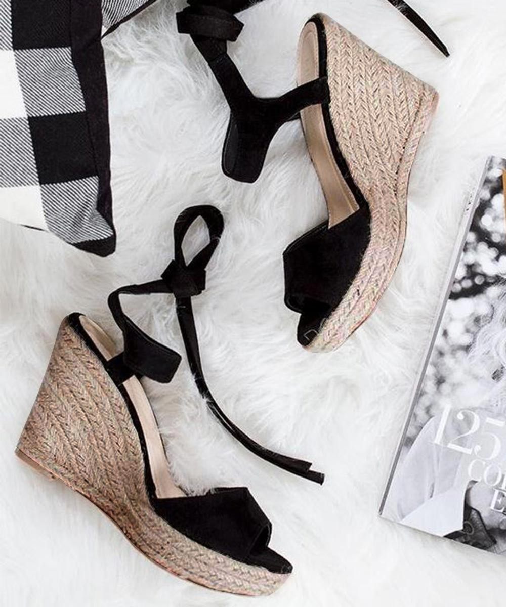 Travel in style black wedges