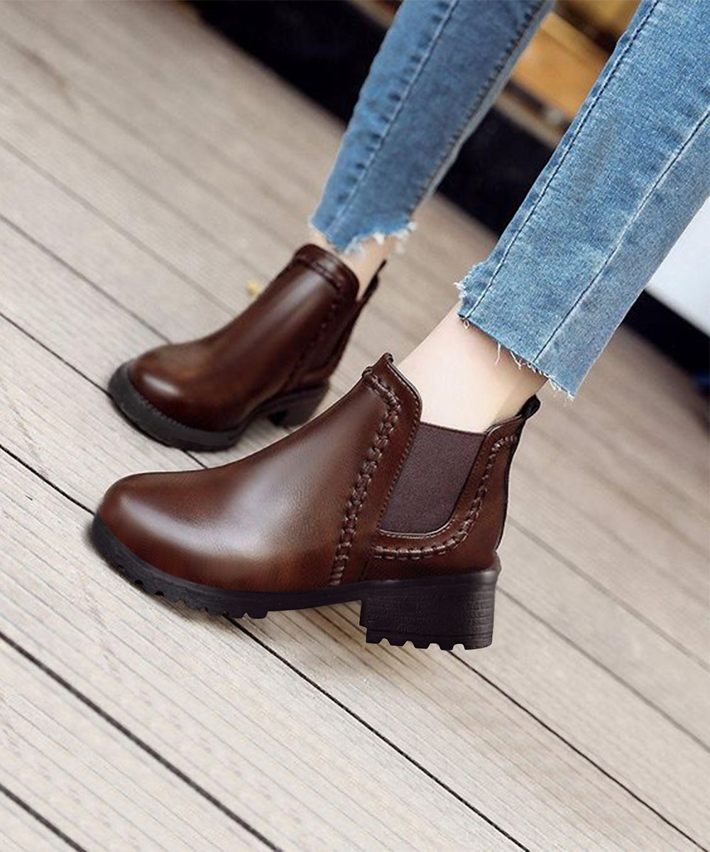 Braided stylish brown boots
