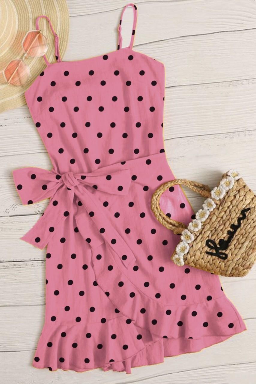 Chic girl in town polka dot dress