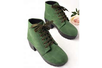 A green vibe boots