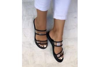 Foot forward transparent black flats