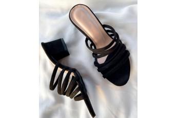 Diva on black strappy heels