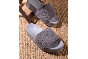 Girl in grey sliders